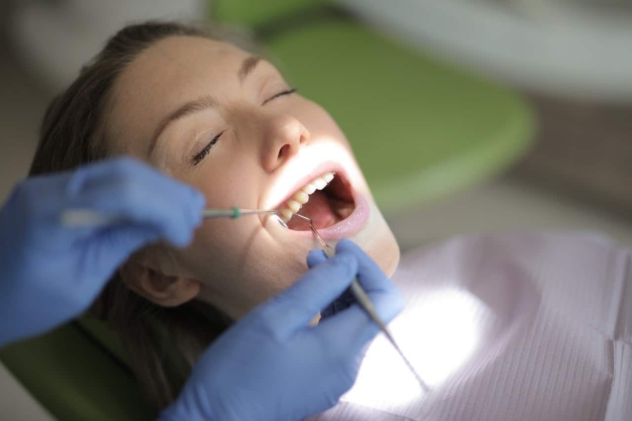 Woman having her mouth examined by a dentist.