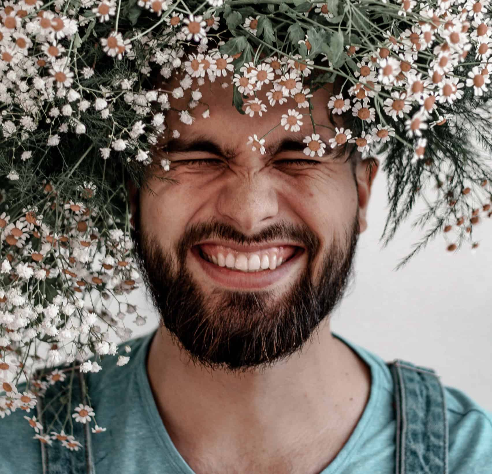Man Smiling with Flowers