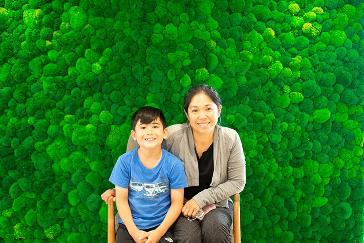 Mother and child smiling in waiting room