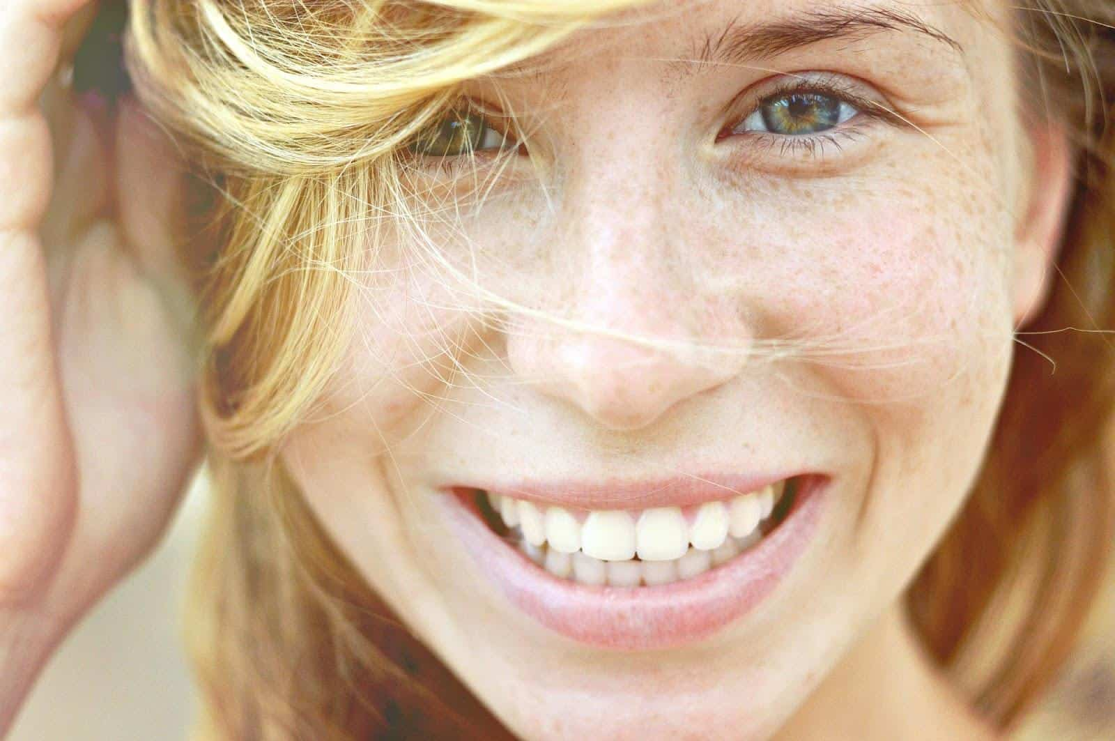 Close-up of a woman's smiling face.